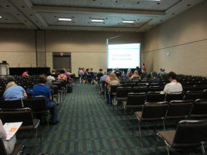a photo of the presentation about the Design for Learning program at the 2016 annual ALA conference, showing audience members seated before a large projection screen